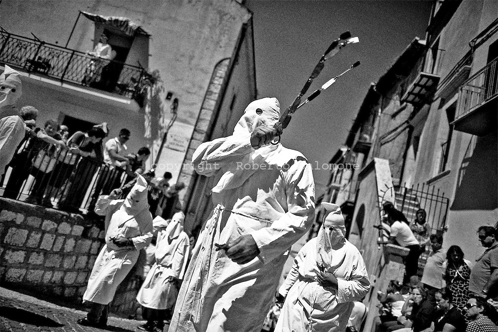 "Christian penitents known locally as ""Battenti"" beat themselves during a procession in honour of the Virgin Mary in Guardia Sanframondi, near Benevento south of Italy. Around 1,000 penitents from across the world attended the procession which occurs once every seven years."