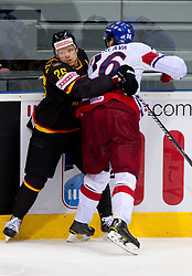 Marcel Muller of Germany vs  Petr Caslava of Czech republic during ice-hockey match between Germany and Czech republic of Group E in Qualifying Round of IIHF 2011 World Championship Slovakia, on May 9, 2011 in Orange Arena, Bratislava, Slovakia. Czech republic defeated Germany 5-2. (Photo By Vid Ponikvar / Sportida.com)