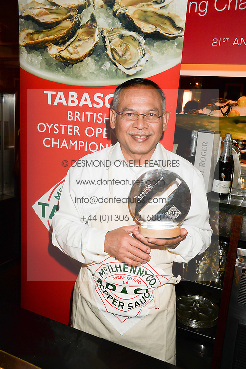 Winner SAM TAMSANGUAN of Wilton's at the Tabasco British Oyster Opening Championship 2013 at J Sheekeys, 28-35 St. Martins Court, London on 9th September 2013.
