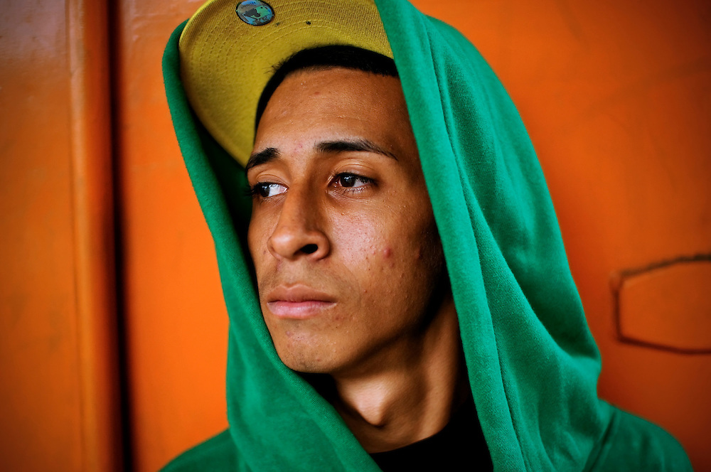 Jackson Ibarra, 20, poses for a portrait at Tiuna el Fuerte in El Valle, a slum on the outskirts of Caracas, Venezuela. Ibarra is one of many young graffiti artists that the Venezuelan government commissions to plaster the city in murals and stencils that promote the Bolivarian revolution and the political agenda of President Hugo Chavez.