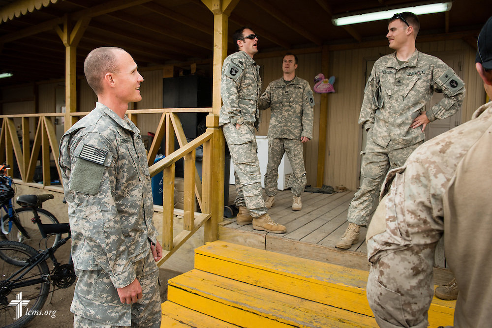 Army Capt. Chad Czischke (left), chaplain, visits with fellow soldiers on Sunday, March 22, 2015, at Camp Buehring in Kuwait. LCMS Communications/Erik M. Lunsford