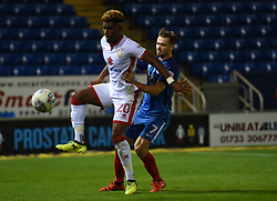 Aaron Tshibola of Milton Keynes Dons in action with Gwion Edwards of Peterborough United - Mandatory by-line: Chantelle McDonald/JMP - 12/09/2017 - FOOTBALL - ABAX Stadium - Peterborough, England - Peterborough United v Milton Keynes Dons - Sky Bet League One