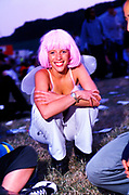 A festival goer in a pink wig and fairy wings, Creamfields, UK 2000's