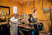 DUBAI, UAE - DECEMBER 18, 2015: Pork corner at the European-style Al Hambra restaurant at Jumeirah Al Qasr Resort. The restaurant offers an extensive menu of authentic tapas and rustic regional Spanish cuisine.