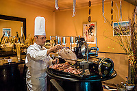 DUBAI, UAE - DECEMBER 18, 2015: Pork corner at the European-style Al Hambra restaurant at Jumeirah Al Qasr Resort. The restaurant offers an extensive menu of authentic tapas and rustic regional Spanish cuisine.