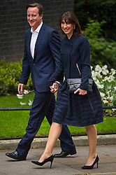 © London News Pictures. 08/05/2015. British prime minister DAVID CAMERON and his wife SAMANTHA CAMERON arrive back at 10 Downing Street in London following election night. Photo credit: Ben Cawthra/LNP