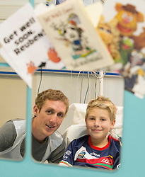 REPRO FREE: 12/11/2014 Irish Profetional Cyclist and world number 9 Dan Martin finished off an eventfull year by visiting the children of Temple Street Hospital. Dan is pictured with 12 year old kidney transplant patient Reuben Walsh from Clonakilty Co. Cork. Dan presented a cheque to the hospital as part of the Cycle4Life initiative witch has raised €500K to date. Picture Andres Poveda
