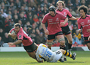 Watford, GREAT BRITAIN, Saracens' Neil  DE KOCK topples, as Wasps' mark MCMILLAN tackles low, during the, second half of the  Guinness Premiership game, Saracens vs London Wasps. 20.04.2008 [Mandatory Credit Peter Spurrier/Intersport Images]