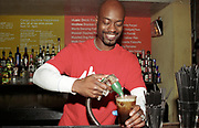 Barman pouring drinks at Cargo, London 2002