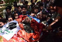 April 25, 2018 - Pulwama, Jammu & Kashmir, India - (EDITORS NOTE: Image contains graphic content.) People carrying the body of Ishfaq Ahmed for burial after the Funeral procession of Ishfaq Ahmed at his residence Handura Village of Tral in south Kashmir's Pulwama District. Ishfaq Ahmed was a local militant who got killed along with his 3 Associates in a 12 hour Long Gunfight In Lam Forests Of Tral On Tuesday 26 April 2018. Reportedly Thousands of peoples including men, women, childrens attended the funeral procession of Ishfaq Ahmed on Wednesday in Tral Some 50 kms away from Srinagar summer capital of Indian Kashmir. Two security forces were also killed and two army men wounded in the gunfight. (Credit Image: © Abbas Idrees/SOPA Images via ZUMA Wire)