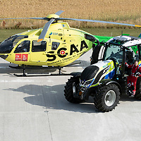 SCAA…Scotland's Charity Air Ambulance 'Helimed 76' pictured with Police Scotland's tractor ahead of the Perth Show on the 4/5th August…The tractor has been loaned to Police Scotland Specialist Crime Division who are responsible for rural and agricultural crimes, pictured paramedic Darren O'Brien.<br />see story by Maureen Young on 07778 779888 or maureenyoung001@gmail.com <br />Picture by Graeme Hart.<br />Copyright Perthshire Picture Agency<br />Tel: 01738 623350  Mobile: 07990 594431