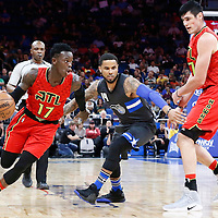25 February 2017: Atlanta Hawks guard Dennis Schroder (17) drives past Atlanta Hawks forward Ersan Ilyasova (7) on a screen set by Orlando Magic guard D.J. Augustin (14) during the Orlando Magic 105-86 victory over the Atlanta Hawks, at the Amway Center, Orlando, Florida, USA.