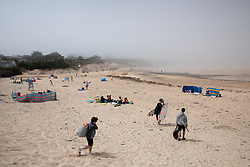 © Licensed to London News Pictures. 27/05/2020. Padstow, UK. A general view of Harlyn Bay, Cornwall as a sea mist engulfs the beach. On Monday, a man died after getting into difficulty in the sea between nearby Constantine Bay and Treyarnon Bay. A teenage girl also died after being trapped in a capsized rigid inflatable boat near Padstow. Multiple other beach related incidents are being reported daily. Due to Coronavirus (COVID-19), the RNLI are currently not operating a Lifeguard service on the beaches in Cornwall, as there would be normally at this time of year. Photo credit : Tom Nicholson/LNP