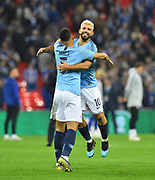 Manchester City are Carabao Cup champions - Sergio Aguero (10) of Manchester City jumps on Danilo (3) of Manchester City as they celebrate after winning a penalty shootout after a 0-0 draw after extra time during the Carabao Cup Final match between Chelsea and Manchester City at Wembley Stadium, London, England on 24 February 2019.