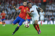 England Forward Raheem Sterling and Spain defender Nacho battle for the ball during the International Friendly match between England and Spain at Wembley Stadium, London, England on 15 November 2016. Photo by Mark Davies.