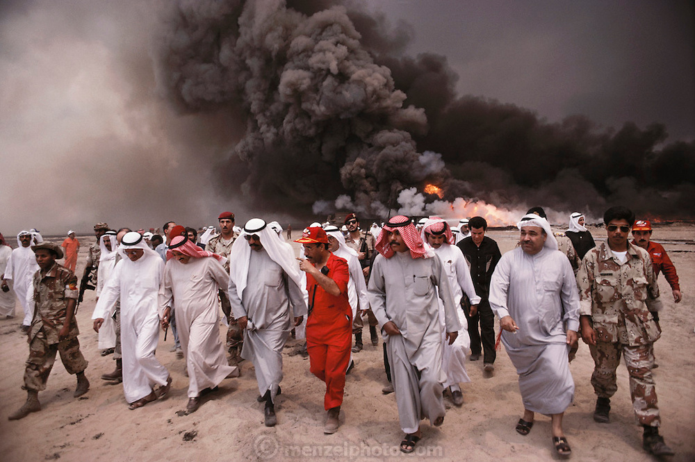 The Crown Prince of Kuwait visiting the oil well fires for the first time in May which were set immediately after the end of the Gulf War. The royal family fled and when they returned they finally went out to see what all the smoke was about in the burning Magwa oil fields near Ahmadi, Kuwait. More than 700 wells were set ablaze by retreating Iraqi troops creating the largest man-made environmental disaster in history.