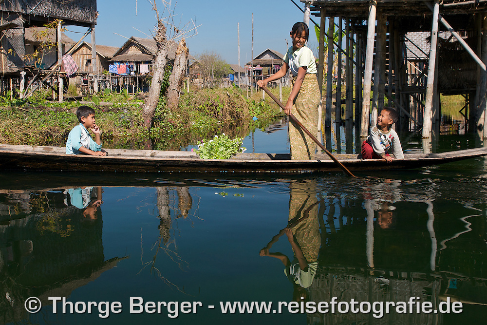 Mother with her sons in a stilt house village on Inle Lake