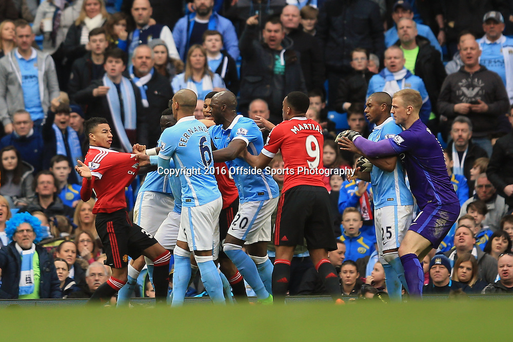 20 March 2016 - Barclays Premier League - Manchester City v Manchester United - Jesse Lingard of Manchester United clashes with City players after Marcus Ashford is denied a penalty after a trip by Martin Demichelis - Photo: Marc Atkins / Offside.