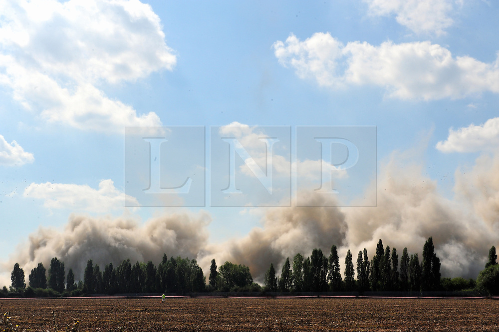 © Licensed to London News Pictures. 07/09/2016<br /> Frame 8<br /> Grain Power Station chimney demolition in Kent.<br /> <br /> One of the country's tallest structures has been demolished this morning at 11am.<br />  The Power Station chimney is 244m (801 ft) which makes it taller than Canary Wharf in London. <br /> <br />  The demolition is a British record for the tallest concrete structure to be blown up!<br /> <br /> <br /> <br /> (Byline:Grant Falvey/LNP)