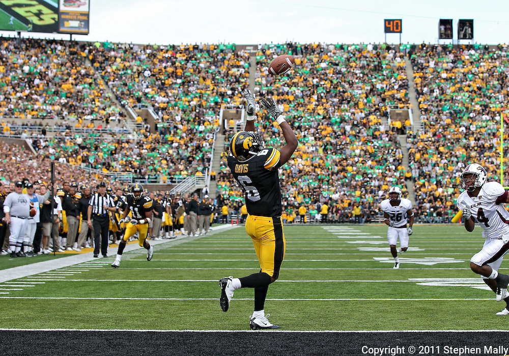 September 24, 2011: Iowa Hawkeyes wide receiver Keenan Davis (6) pulls in a 23 yard touchdown catch during the third quarter of the game between the Iowa Hawkeyes and the Louisiana Monroe Warhawks at Kinnick Stadium in Iowa City, Iowa on Saturday, September 24, 2011. Iowa defeated Louisiana Monroe 45-17.
