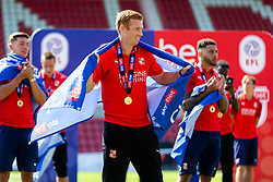(Free to use courtesy of Sky Bet) Eoin Doyle looks on as Swindon Town gather at The County Ground to celebrate becoming Sky Bet League Two Champions, with a socially distanced trophy lift, after the curtailment of the regular season due to the Covid-19 pandemic - Rogan/JMP - 26/06/2020 - The County Ground - Swindon, England - Sky Bet League 2.