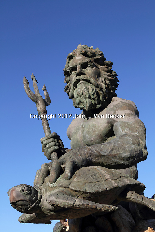 A cast bronze statue of Neptune on the Virginia Beach, Va, boardwalk. The statue is the work of sculptor Paul DiPasquale, and was dedicated on September 30, 2005 to the City of Virginia Beach during the Neptune Festival Boardwalk Weekend.