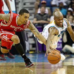 April 6, 2011; New Orleans, LA, USA; New Orleans Hornets point guard Jarrett Jack (2) and Houston Rockets shooting guard Courtney Lee (5) scramble for a loose ball during the fourth quarter at the New Orleans Arena. The Hornets defeated the Rockets 101-93 and clinched a playoff spot with the victory.   Mandatory Credit: Derick E. Hingle-US PRESSWIRE