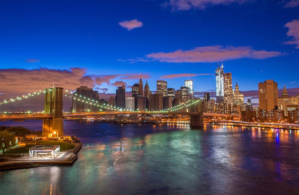 Brooklyn bridge and New York city skyline at night taken from Manhattan bridge