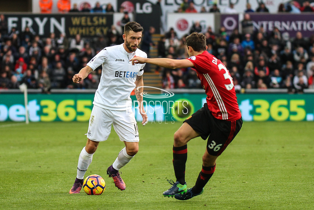 Gonzalez Borja Baston of Swansea City and Matteo Darmian of Manchester United during the Premier League match between Swansea City and Manchester United at the Liberty Stadium, Swansea, Wales on 6 November 2016. Photo by Andrew Lewis.