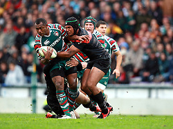 Vereniki Goneva of Leicester holds off Thierry Dusautoir during the Heineken Cup match between Stade Toulouse and Leicester Tigers at Stade Municipal on October 14, 2012 in Toulouse, France.  Eoin Mundow/Cleva Media