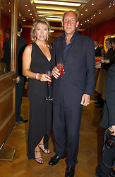 VISCOUNT & VISCOUNTESS DAVENTRY at '4 Inches' a project 'For Women about Women By Women' - A photographic Auction in aid of the Elton John Aids Foundation hosted by Tamara Mellon President of Jimmy Choo and Arnaud Bamberger MD of Cartier UK at Christie's, 8 King Street, London W1 on 25th May 2005.<br />