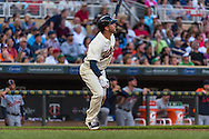 Trevor Plouffe #24 of the Minnesota Twins watches his home run against the Detroit Tigers on June 15, 2013 at Target Field in Minneapolis, Minnesota.  The Twins defeated the Tigers 6 to 3.  Photo: Ben Krause