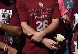A Marjory Stoneman Douglas High School football player holds a rose as students, staff, parents, friends and community leaders gather in Parkland, FL, USA, on Thursday, February 15, 2018, in the wake of a shooting that left 17 dead a day earlier. Photo by Taimy Alvarez/Sun Sentinel/TNS/ABACAPRESS.COM