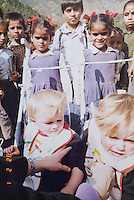 Ruth and Rosa as toddlers in Nepal. Ruth and Rosa Hollows story at Pullarhari Monestry for the outreach micro surgical eye camp held on the outsirks of the Kathmandu Valley 2014.