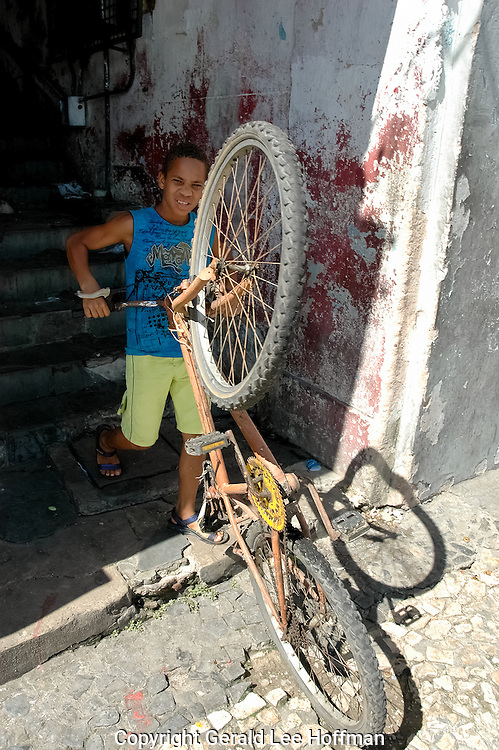Boy and Bike Salvador, Brazil. In the lower city.