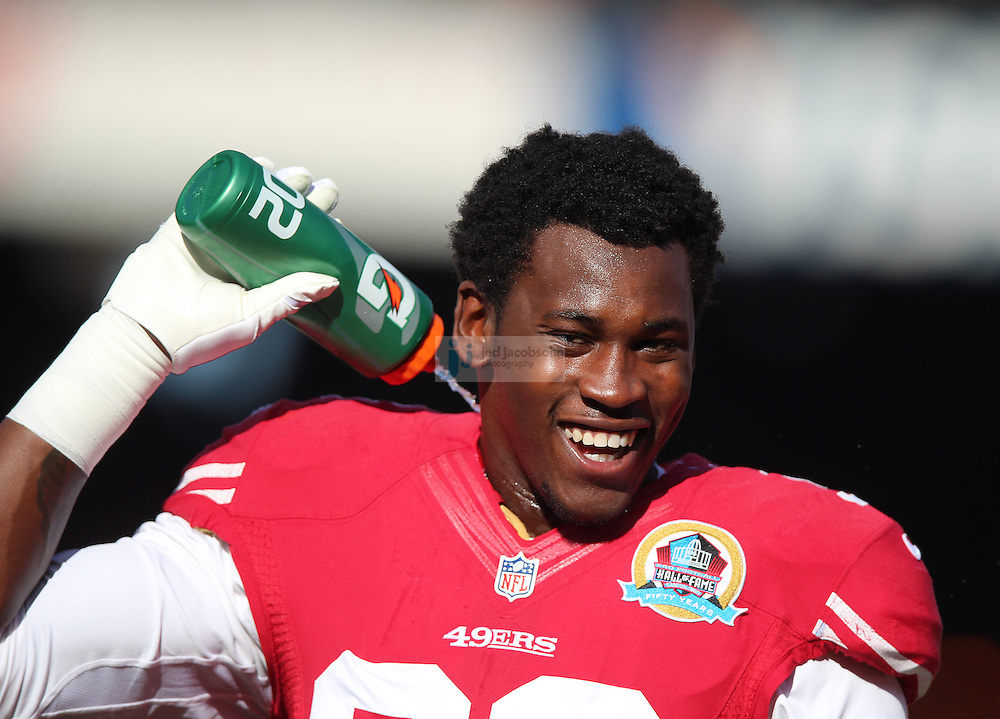 San Francisco 49ers outside linebacker Aldon Smith (99) warms up against the Miami Dolphins during an NFL game at Candlestick Park on December 9, 2012 in San Francisco, CA.  (Photo by Jed Jacobsohn)