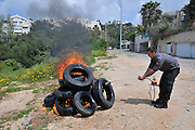 Fireman lights tyres as part of a fire fighting drill