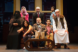 """© Licensed to London News Pictures. 08/10/2014. London, England. Kev Orkian as Mahmoud at the centre. The Musical """"The Infidel"""", based on the same named film by David Baddiel,  premieres at the Theatre Royal Stratford East, London. Directed by David Baddiel and Kerry Michael, book and lyrics by David Baddiel with music by Erran Baron Cohen. The Infidel is a story about Muslim man Mahmoud (Kev Orkian) who discovered that he is not only adopted but also Jewish. Photo credit: Bettina Strenske/LNP"""