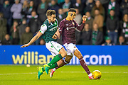 Darren McGregor (#24) of Hibernian FC tackles Sean Clare (#9) of Heart of Midlothian during the Ladbrokes Scottish Premiership match between Hibernian FC and Heart of Midlothian FC at Easter Road Stadium, Edinburgh, Scotland on 29 December 2018.