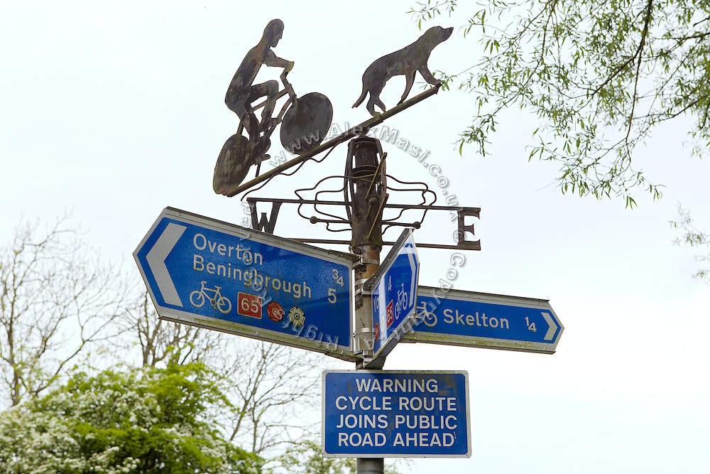 Signed of different bike routes are standing in the countryside near York, Yorkshire, England, United Kingdom.