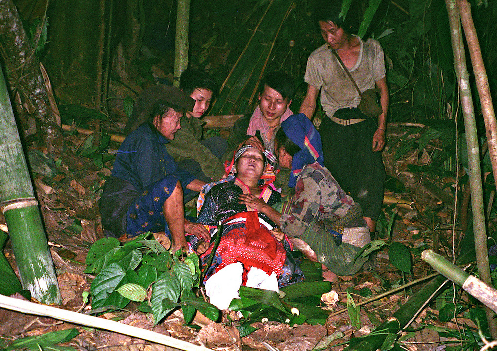 Mrs. Bao Thao, 32 years old, killed April 6, 2006.....Pictured are a group of Hmong people who report an attack against them April 6, 2006 by Lao and Vietnamese military forces.  26 people perished, 5 were injured, and 5 babies died shortly after because their dead mothers could not breast-feed them.  Only one adult male was killed, the other 25 victims were women and children (17 children).  ....