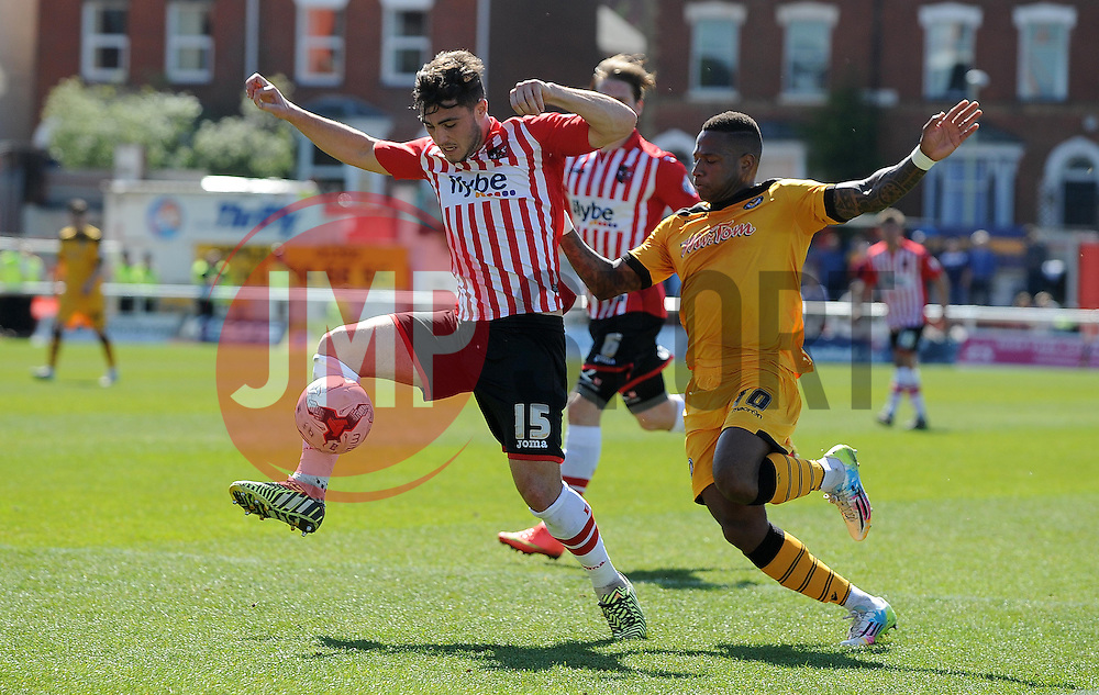 Exeter City's Jordan Moore-Taylor is tackled by Newport County's Aaron O'Connor - Photo mandatory by-line: Harry Trump/JMP - Mobile: 07966 386802 - 06/04/15 - SPORT - FOOTBALL - Sky Bet League Two - Exeter City v Newport County - St James Park, Exeter, England.
