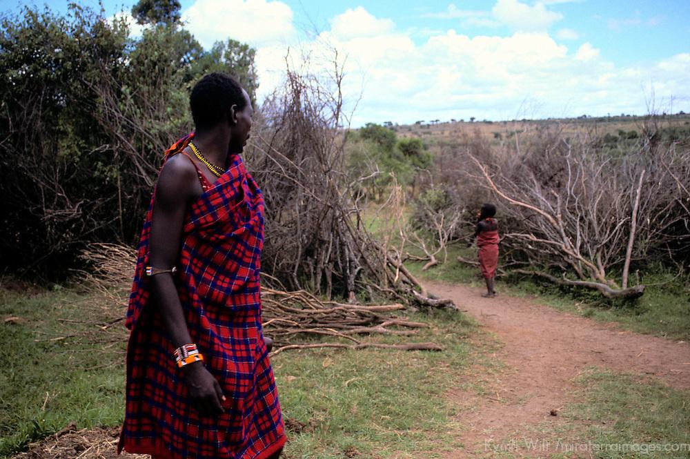 Africa, Kenya, Maasai Mara. At the entrance to the Maasai boma at Olanana.
