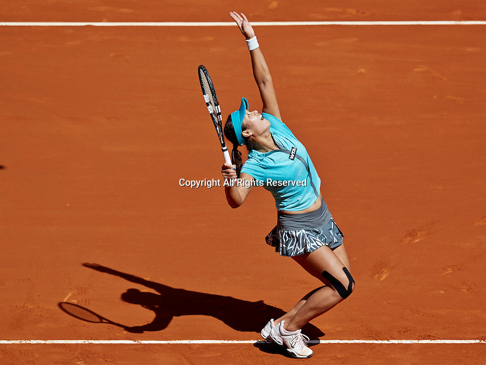 06.05.2014 Madrid, Spain. Na Li of China serves the ball during the game with on day 3 of the Madrid Open from La Caja Magica.
