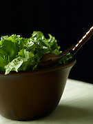 Green Lettuce in Wooden Salad Bowl