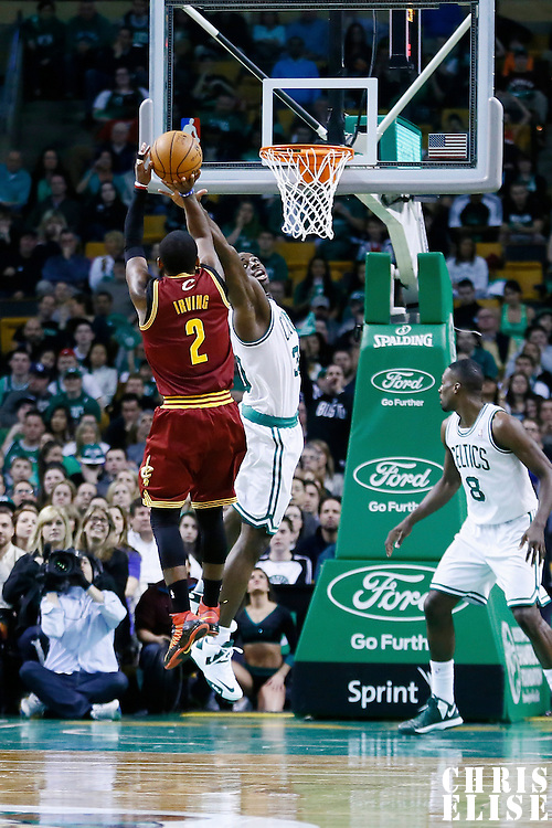 05 April 2013: Cleveland Cavaliers point guard Kyrie Irving (2) takes a jumpshot over Boston Celtics power forward Brandon Bass (30) during the Cleveland Cavaliers 97-91victory over the Boston Celtics at the TD Garden, Boston, Massachusetts, USA.