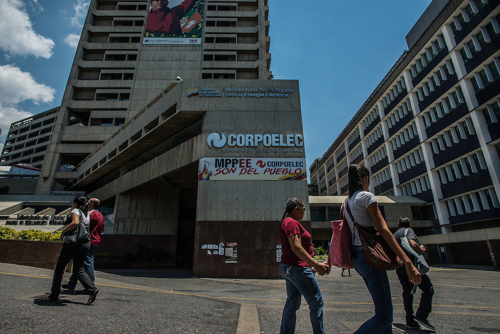 "CARACAS, VENEZUELA -MARCH 21, 2016: People walk past the headquarters of Corpoelec, the state power corporation of Venezuela in downtown Caracas.  Venezuela is shutting down this week, as the government struggles with a deepening electricity crisis.  President Nicolas Maduro gave everyone an extra three days off work, extending the two-day Easter holiday, according to a statement in the Official Gazette published late last Tuesday.  The government has rationed electricity and water supplies across the country for months and urged citizens to avoid waste as Venezuela endures a prolonged drought that has slashed output at hydroelectric dams. The ruling socialists have blamed the shortage on the El Nino weather phenomena and ""sabotage"" by their political foes, while critics cite a lack of maintenance and poor planning.  PHOTO: Meridith Kohut for Bloomberg News"