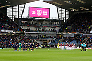 The teams observe the minutes silence during the Premier League match between Burnley and West Ham United at Turf Moor, Burnley, England on 9 November 2019.