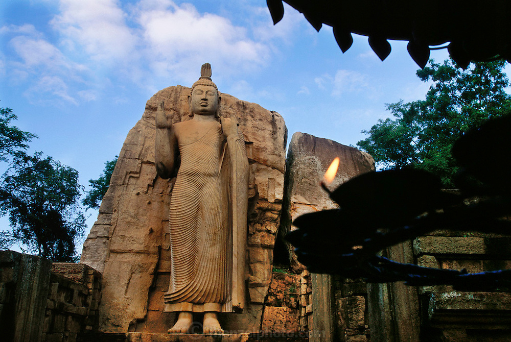 5th century Buddha: a 12 meters tall granite statue of Buddha, hewn out of solid rock in the standing posture on a lotus pedestal. The statue was built during the reign of King Dhatusena in the 5th century AD. Awkana, Sri Lanka.