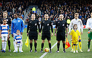 Match officials an captains stand side by side before the Sky Bet Championship match between Queens Park Rangers and Leeds United at the Loftus Road Stadium, London, England on 28 November 2015. Photo by Andy Walter
